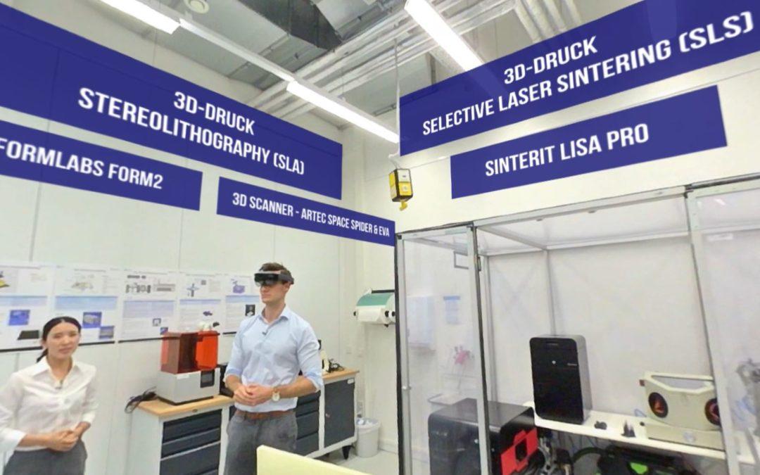Screenshot aus dem 360°-Video: Forschende zeigen die technische Ausstattung des Logistik Labors wie 3D-Drucker, AR-Brillen.